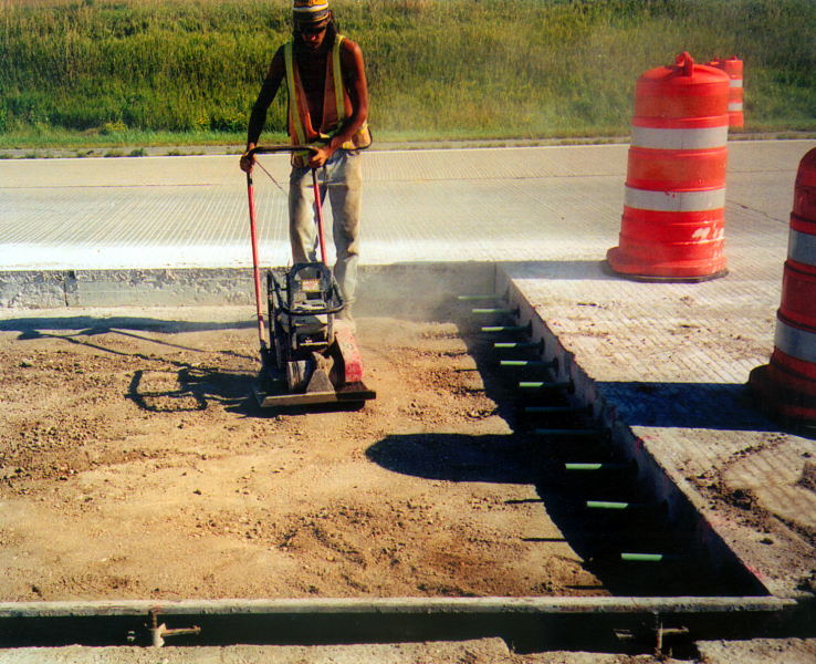 File:Recompaction of backfill immediately prior to placement of the new concrete surface course.png