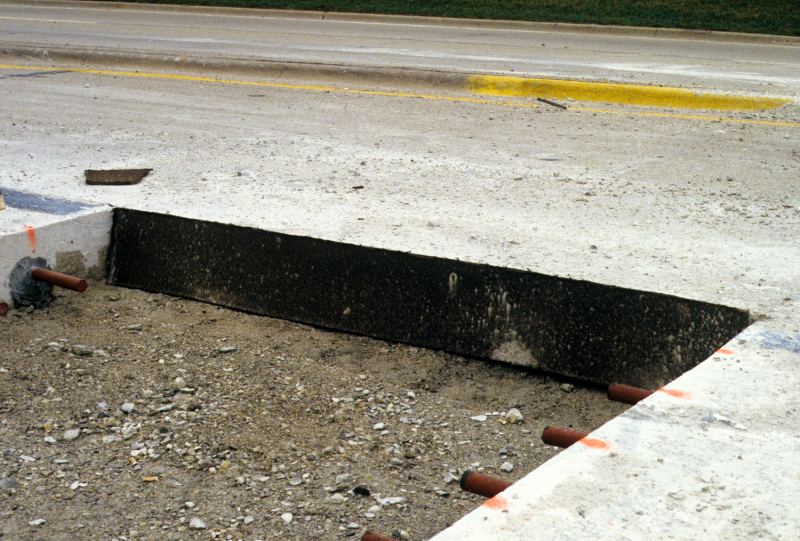 File:Fiber-board bond breaker placed along the longitudinal joint between the existing pavement and the utility cut.png