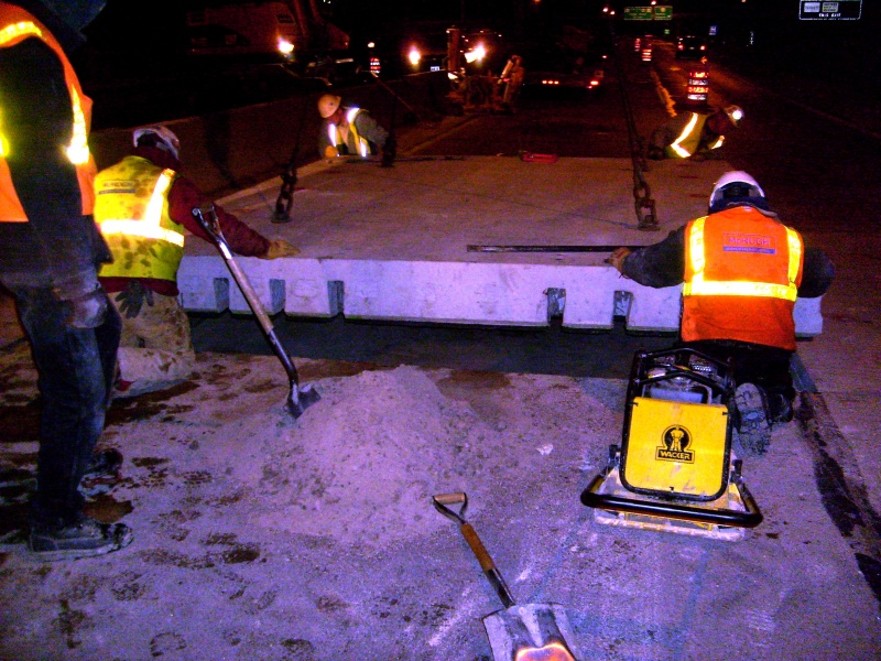 File:Positioning of a precast panel during a utility-related repair in a nighttime closure.jpg